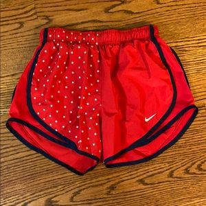 Red Nike Shorts with White Star Design